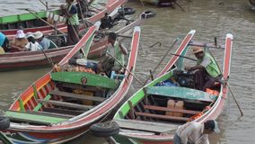 PORT, QUAY & JETTY:  ASIA - Medium shot of two colorful passenger boats. Medium shot of two colorful passenger boats waiting for passengers in port; From stock footage