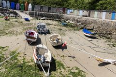 Small boats suspended on the ship in the smallest port of France, Port Racine, Cotentin peninsula. PORT RACINE, CHERBOURG, NORMANDY, FRANCE - JUNE CIRCA, 2018 stock images