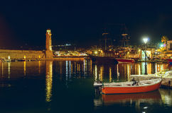 Port Rethymno at night. Crete. Greece. Focus on the lighthouse Royalty Free Stock Photography