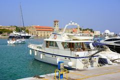 Port of Rhodes town with moored fishing boats near the pier. Royalty Free Stock Photos