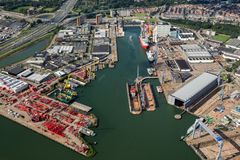 Port of Rotterdam shipping companies. ROTTERDAM, THE NETHERLANDS - SEP 2, 2017: Aerial view of various shipping and industrial companies in the Port of Rotterdam stock photography