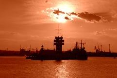 Port rouge de coucher du soleil Photos stock