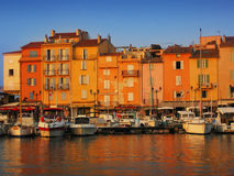 Port in Saint-Tropez. Yachts in port of Saint-Tropez (France) in sunset time stock image