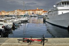 Port of Saint Tropez. Port de Saint Tropez in France with bike in the foreground royalty free stock photos