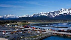 Port of Seward, Alaska. Industrial loading area against the mountain backdrop of Seward, Alaska Stock Photography