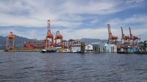 Port shipping. A port shipping dock with cranes unloading Royalty Free Stock Photos