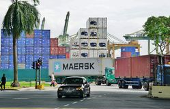 The Port of Singapore Authority (PSA) manages busy cargo container traffic at the port of Singapore Royalty Free Stock Photo