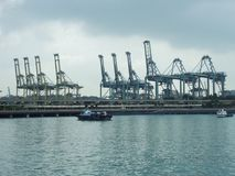 Port of Singapore that conduct maritime trade handling functions in harbours and which handle Singapore`s shipping. SINGAPORE. – On January 7, 2014 - Port of royalty free stock images
