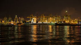 Port of Singapore Industrial Scene at Night 1920x1080 Royalty Free Stock Images