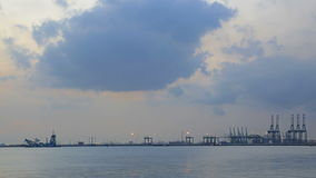 Port of Singapore from Labrador Park with Water Reflection at Night with Blue Sky and Moving Clouds Time Lapse 1080p Stock Image