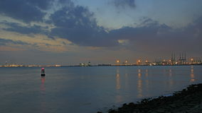 Port of Singapore from Labrador Park with Water Reflection at Night with Moving Clouds Time Lapse 1080p Stock Photos