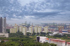Port of Singapore Shipyard and Housing Apartment Buildings Royalty Free Stock Images