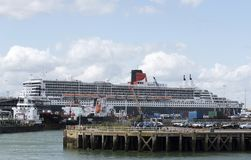 Cruise ship Queen Mary 2. Southampton Docks UK. Port of Southampton England UK. August 2017. Cruise ship Queen Mary 2 alongside the quay in this busy port Royalty Free Stock Photography