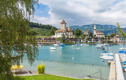 Port in Spiez. View on beautiful small city, lake Thun, marine and many boats. City of Spiez, canton Bern, Switzerland Stock Photos