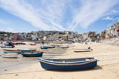 Port St. Ives, Cornwall, UK. SAINT IVES, CORNWALL - AUGUST 8: Tourists and locals enjoy the beach during a low tide in St. Ives, in Cornwall, Southern UK August Stock Photography