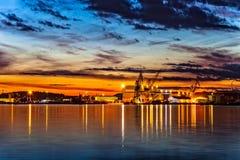 Port of Stavanger. Sunset over an industry harbor with cranes in Stavanger, Norway Stock Photos