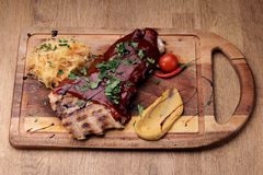 Port steak with red sauce Stock Photography