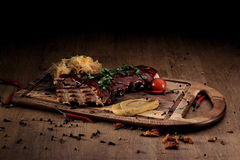 Port steak with red sauce Royalty Free Stock Photo