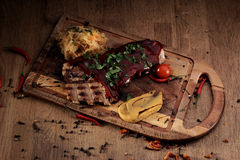 Port steak with red sauce Stock Image