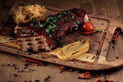 Port steak with red sauce Royalty Free Stock Photos