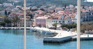 Port of Supetar, Croatia. Viewed trough sailing boat ropes royalty free stock photo