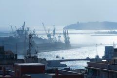 Port of Tarragona.Spain. Cargo port of Tarragona with shines on the sea Stock Photos