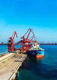 Port terminal. The port is a transport hub with the sea and land transport equipment and conditions, for the safety of the ship. Is the amphibious transportation Royalty Free Stock Photos