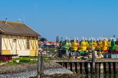 Port terschelling facing the stored buoys Stock Photography