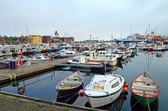 Port of Torshavn, Faroe Islands. Torshavn, Faroe Islands - June 05, 2014: Trawler and pleasure boats in the port of Torshavn in the Faroe Islands. Fishing is an Royalty Free Stock Photos