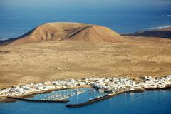 The port town of Caleta del Sebo seen from the neighbouring island of Lanzarote Stock Images