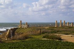 Port and town ruins in Caesarea.Israel. Caesarea Maritima, was a city and harbor built by Herod the Great about 25�13 BC, on the Mediterranean coast of Israel Stock Photos