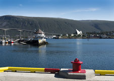 Port of Tromso. View of the Artic Cathedral and bridge from port of Tromso Stock Photo