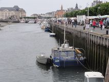 The Port of Trouville-sur-Mer is the harbour of the city of Trouville-sur-Mer, France. The large town`s position on the estuary of the River Touques was a Stock Photos
