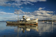 Port in Ushuaia. Picturesque view of an old ship in the port in Ushuaia Stock Photo
