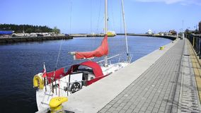 Port of Ustka, with anchored sail boat stock video footage