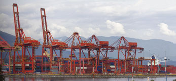 Port of Vancouver BC Cranes and Containers. Port of Vancouver BC Canada with Red Cranes and Shipping Containers at Shipyard Panorama Stock Image