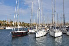Port Vell, Barcelona. A row of yachts at Port Vell in Barcelona Stock Photography