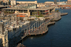 Port Vell in Barcelona. Tourists walking down the pier at Port Vell in Barcelona Spain Stock Photography
