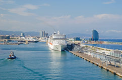 Port Vell of Barcelona with cruise terminal. Barcelona, Spain - June 2, 2016: View of  port Vell and cruise terminal with two cruise-liners  and pilot boat, W Royalty Free Stock Photo