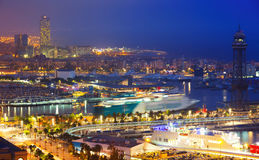 Port Vell and  Barcelona in evening Stock Photos