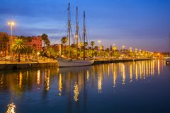 Port Vell and embankment of Barcelona. Port Vell and embankment illumonated at night, Barcelona, Spain Royalty Free Stock Photo