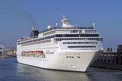 Port view of cruise ship  departing quayside Stock Image