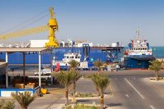 Port view with moored ships, Saudi Arabia. RAS TANURA, SAUDI ARABIA - MAY 14, 2014: Port view with moored ships, Saudi Arabia Stock Photo
