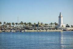 Port view and tower lighthouse, Malaga, Spain. stock images