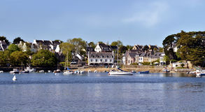 Port and village of Sainte-Marine in France. Panoramic of port and village of Sainte-Marine and dependent city Combrit, on the bank of Odet river, commune in the stock image