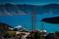 The port on the volcanic island named Nea Kameni. Stock Photos