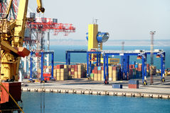Port warehouse with cargoes and containers Royalty Free Stock Image