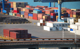 Port warehouse with cargoes and containers Stock Image