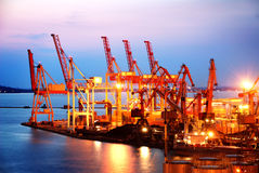 Port warehouse with cargoes and containers Royalty Free Stock Photo