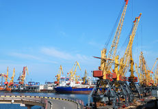 Port warehouse with cargoes and containers Royalty Free Stock Photos
